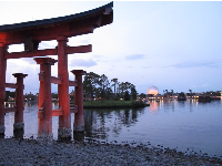 Japanese sculptures and water, as night descends at Epcot.