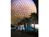 The Spaceship Earth geosphere lit at night.