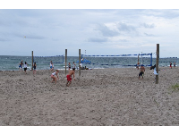 Volleyball players enjoy the southern end of the beach.