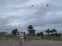 Flying kites on a stormy day at Delray Beach.