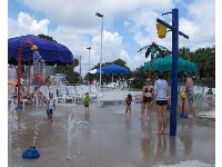 Kids and parents enjoy the splash pad.
