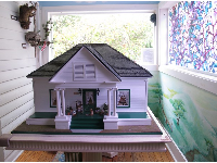 Model of the house, plus purple stained glass window.