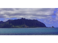 View of Chinaman's Hat from afar.