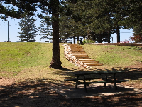 Picnic table and sandstone stairs.