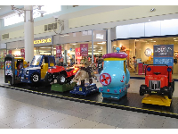 The coin-operated cars.