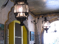 Ironwork lanterns and stenciled decorations.