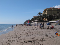 People enjoying a winter day at Lantana Beach.