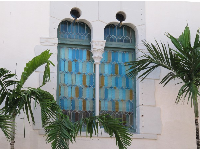 Stained glass windows and palms.