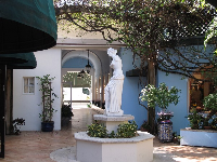 Statue in pale blue courtyard.