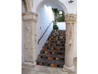 Colorful tiled stairs and decorated column.