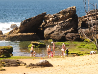 Mothers and children enjoying an October morning at the rock pools.
