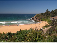 View of Warriewood and the Surf Lifesaving Club from street above the beach.
