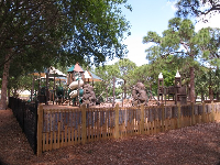 The playground, which is surrounded by a fence.