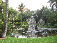 Three massive cube sculptures created by Frabel in the large pond.