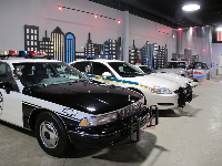 Police cars and city buildings.