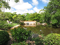 Earthen bridge leading to turtle island and the museum building.