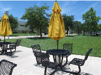 Chairs and tables outside on a gorgeous day on campus.