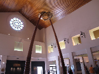 Foyer with high, wooden ceiling.