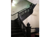 Ornate dark-wood staircase inside Plant Hall.