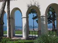 Ocean view through arched walkway.