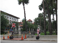 Tourists on segways in front of campus.
