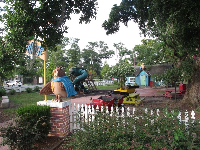 Birthday Party Village with its owl sculpture and playground.
