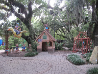 The three little pigs, the house of brick, the house of wood, and Mother Goose flying- all in the beautiful forest!