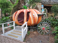 Cinderella's pumpkin carriage and the rat who is the coachman.