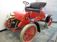 1903 Cadillac. The engine of the car displayed has one of the oldest serial numbers in existence.