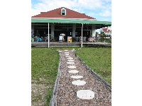 The boathouse, where you can get an ice cream popsicle. See the cute sand dollar stepping stones.