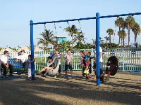 Crowded weekend day at the swings.